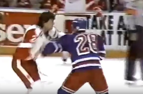 Tie Domi and Bob Probert fight it out on the ice during a 1992 hockey game.
