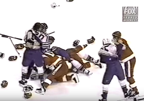 Members of the 1997 Detroit Red Wings and St. Louis Blues fight on the ice.
