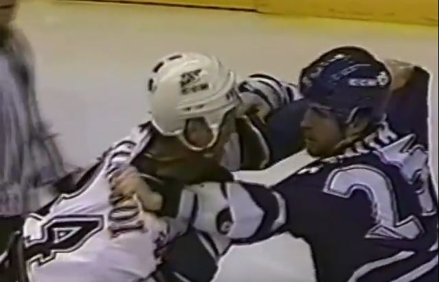 Mark Tinordi and Jason Smith fighting on the ice in 1998
