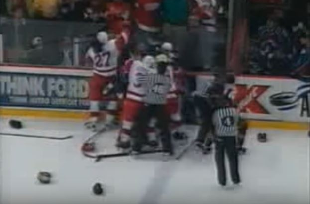 Members of the 1998 Detroit Red Wings and Colorado Avalance fighting on the ice