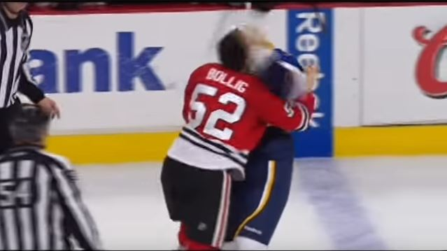Brandon Bollig of the Blackhawks fighting with an opposing team member