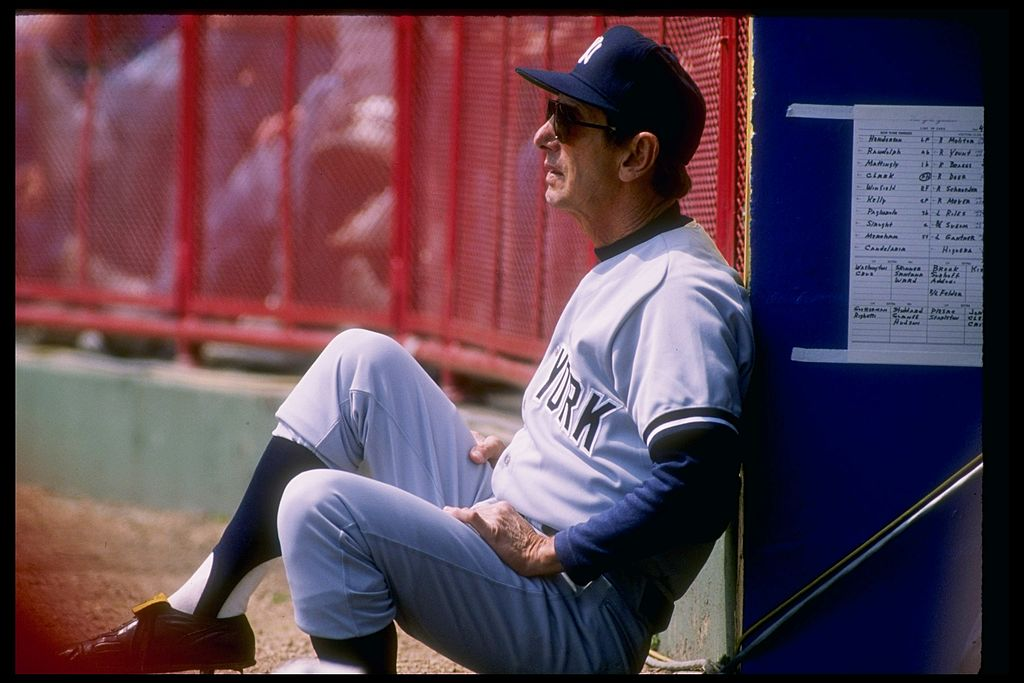 Billy Martin of the New York Yankees watches from the dugout