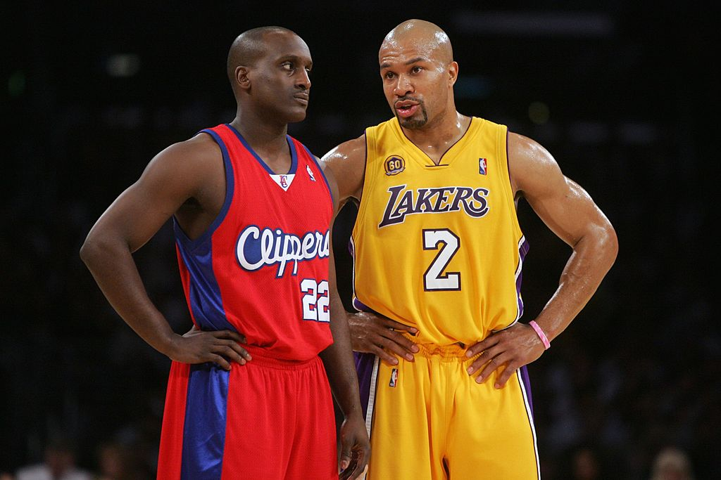 Derek Fisher of the Los Angeles Lakers talks with Brevin Knight of the Los Angeles Clippers