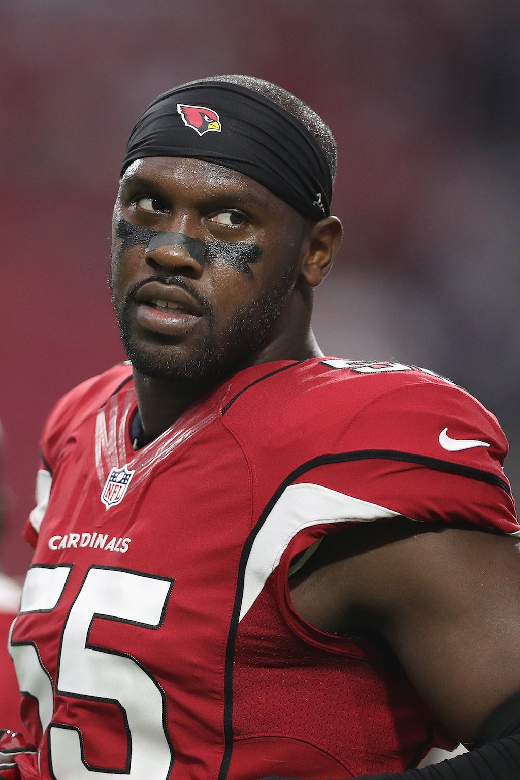 The Arizona Cardinals' Chandler Jones looks on from the sidelines