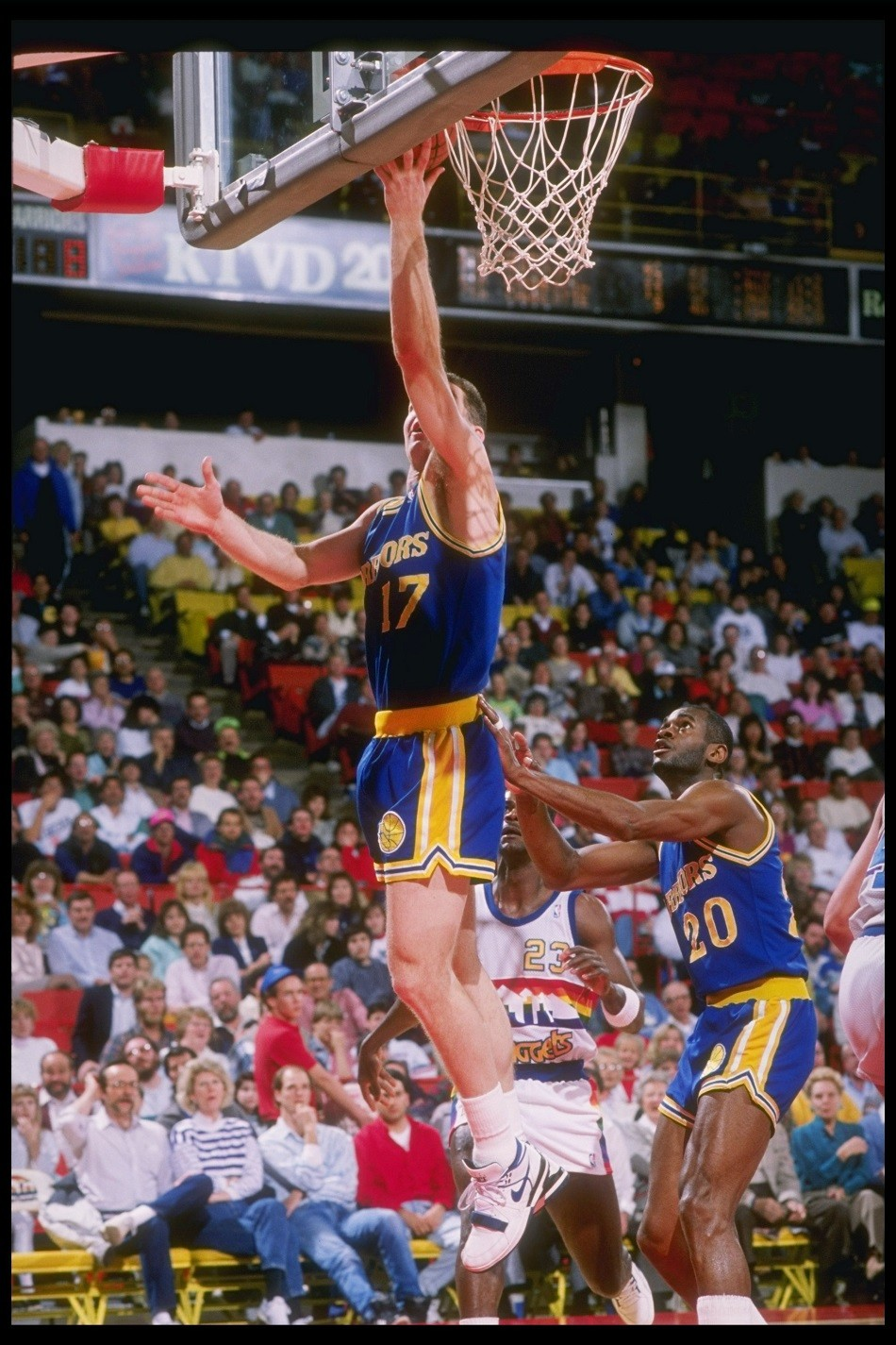 Chris Mullin of the Golden State Warriors lays up during a game