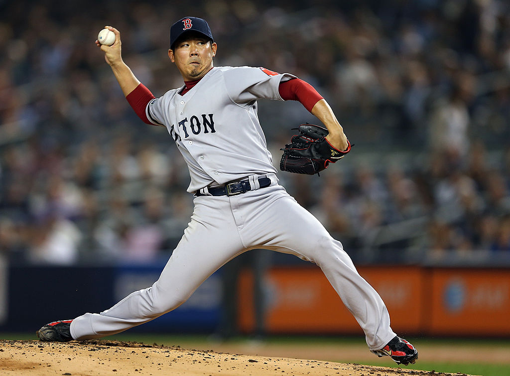 Daisuke Matsuzaka of the Boston Red Sox winding up to pitch