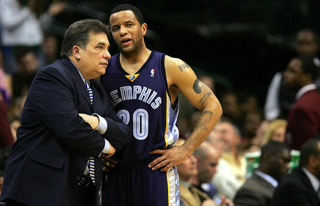 Head coach Tony Barone talks with Damon Stoudamire
