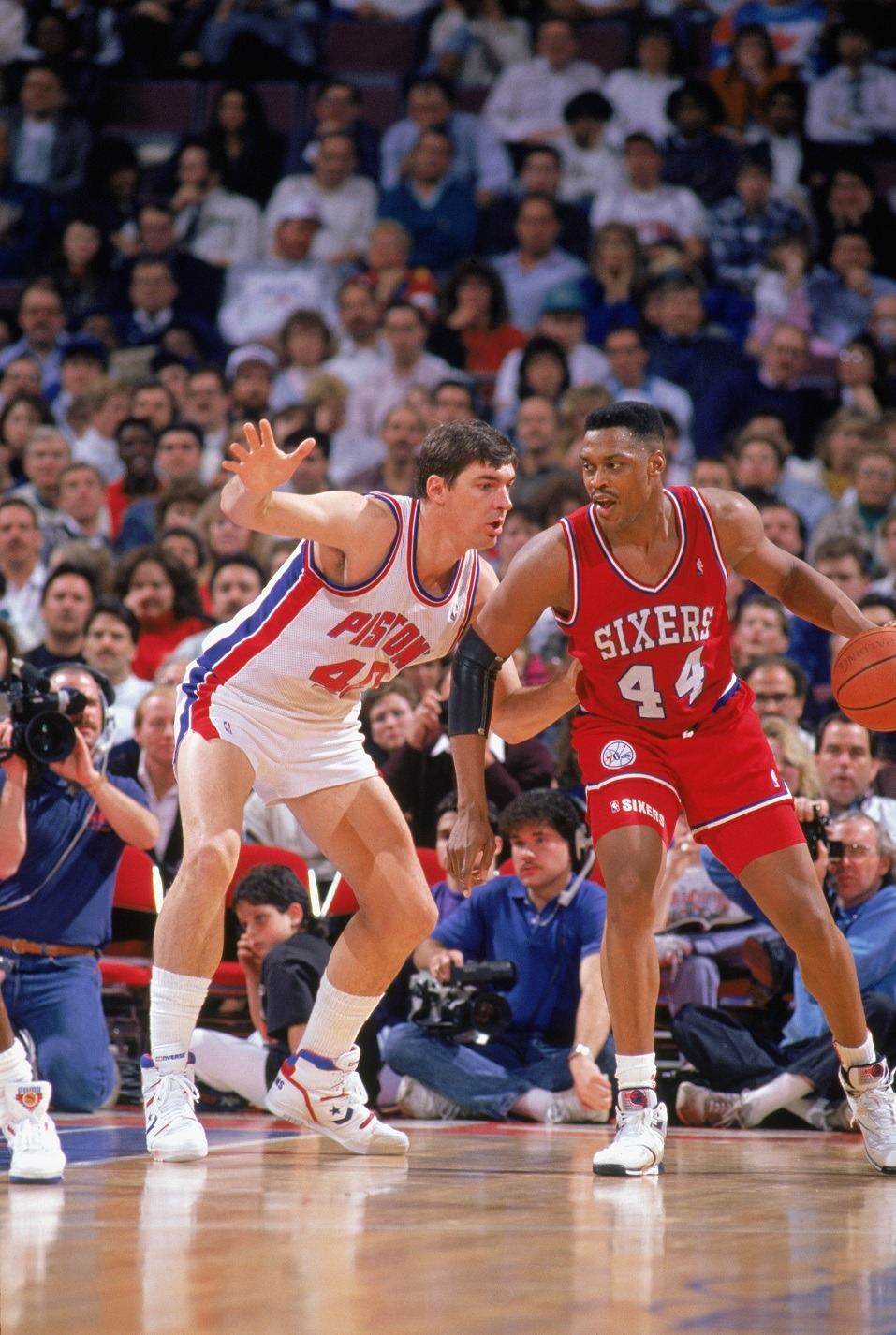 Rick Mahorn of the Philadelphia 76ers is defended by Bill Laimbeer of the Detroit Pistons