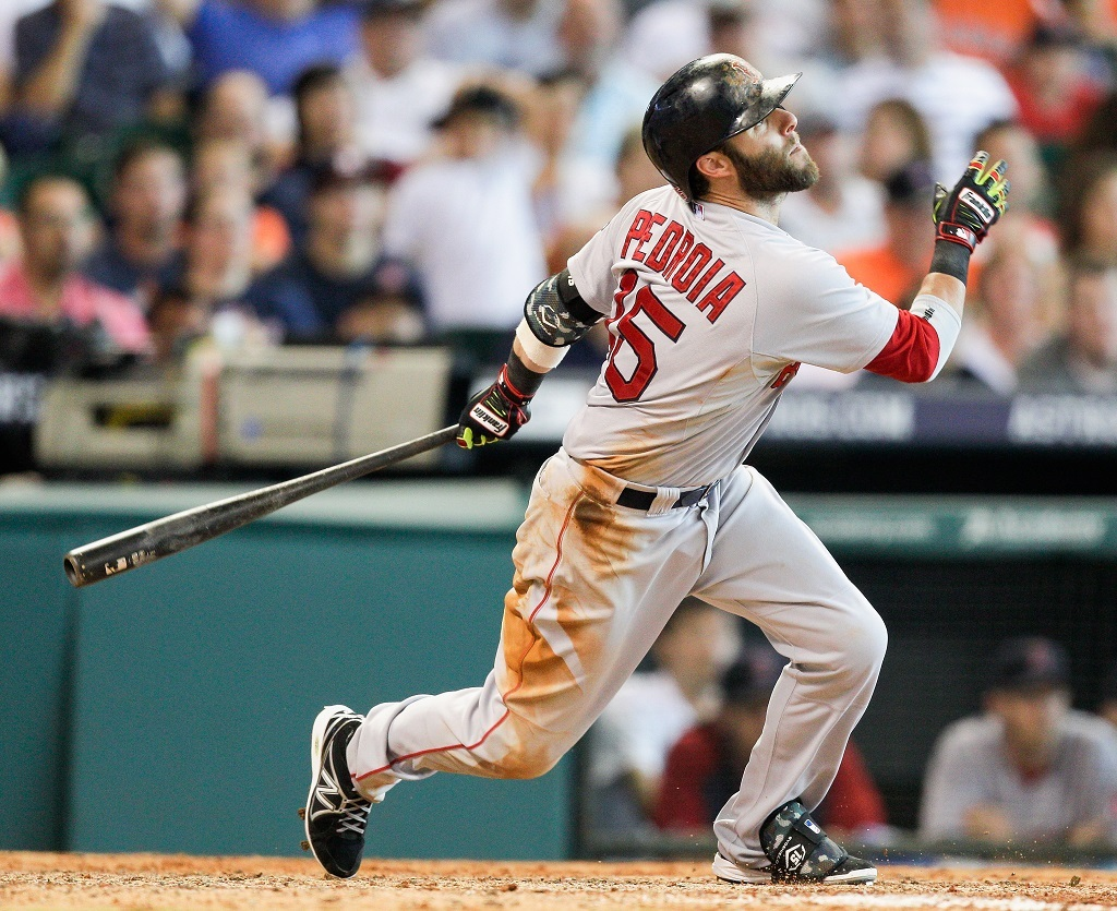Dustin Pedroia #15 of the Boston Red Sox hits a sacrifice fly in the seventh inning against the Houston Astros