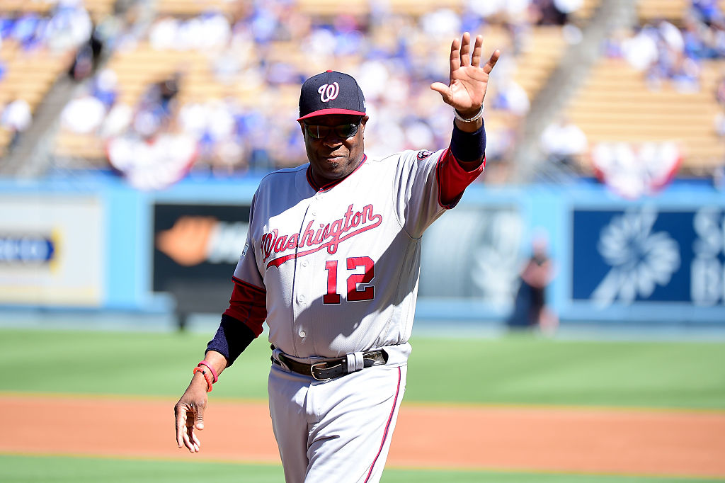 Manager Dusty Baker of the Washington Nationals waves to fans.