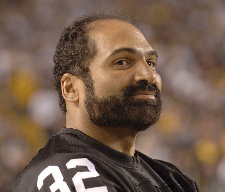 Franco Harris smiles as he's recognized by Steelers fans.