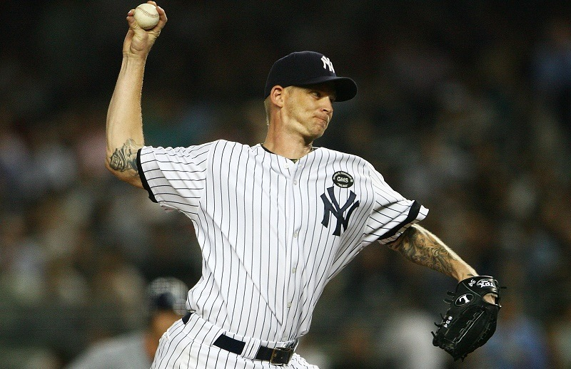 A.J. Burnett of the New York Yankees pitches against the Tampa Bay Rays in 2010