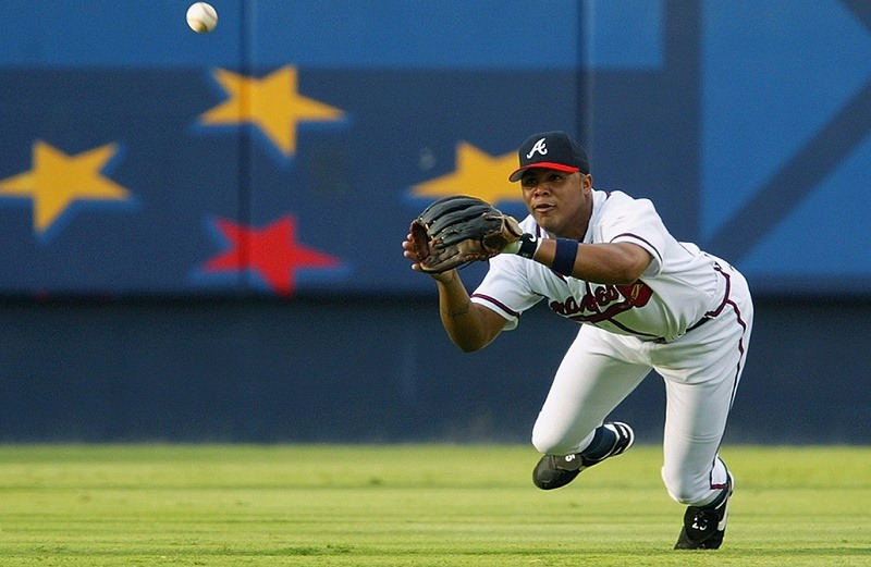 ATLANTA - JULY 31: Centerfielder Andruw Jones #25 of the Atlanta Braves dives for a ball during the MLB game against the Milwaukee Brewers at Turner Field on July 31, 2002 in Atlanta, Georgia.