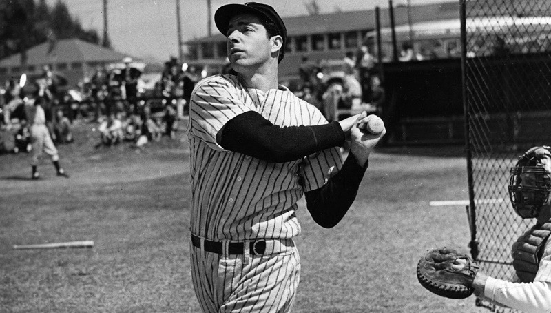 American baseball player Joe DiMaggio (1914 - 1999) hits a belter, circa 1948.