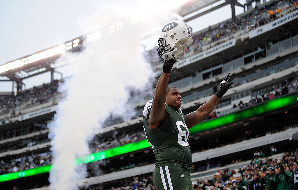 D'Brickashaw Ferguson of the New York Jets gestures to fans from the field