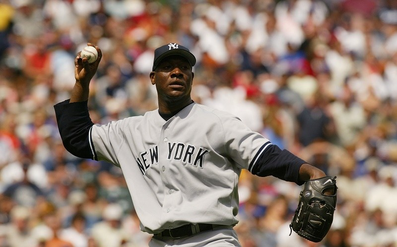 Pitcher Jose Contreras of the New York Yankees delivers against the Texas Rangers in 2004