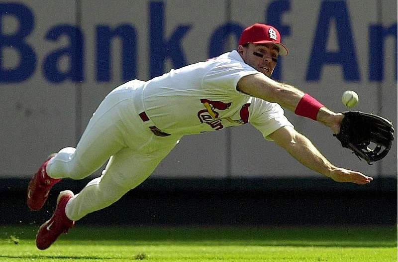 ST. LOUIS, UNITED STATES: St. Louis Cardinals player Jim Edmonds makes a diving attempt on a ball hit by the Atlanta Braves' Rafael Furcal in the first inning of game one of the National League Division Series Playoffs 03 October 2000 at Busch Stadium in St. Louis, Missouri. Edmonds did not make the catch but Furcal was later thrown out attempting to steal second.