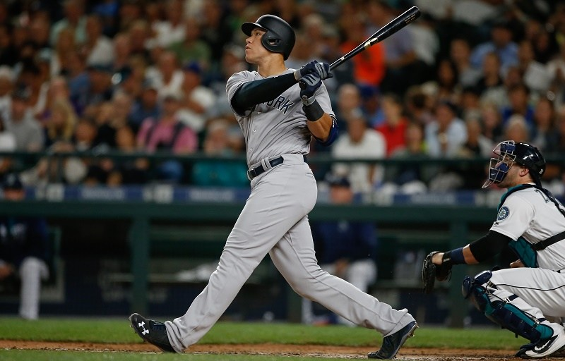 Aaron Judge #99 of the New York Yankees hits a sacrifice fly scoring Mark Teixeira in the sixth inning against the Seattle Mariners.