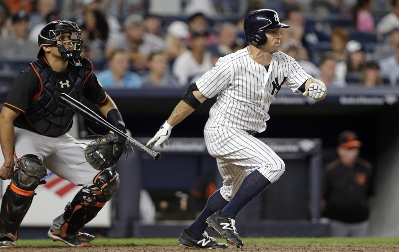 Brett Gardner of the New York Yankees hits an RBI single.