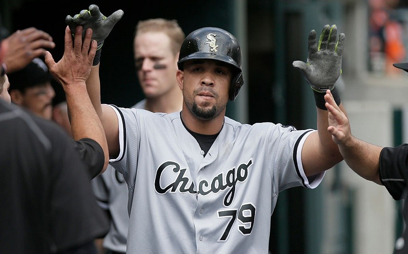 Jose Abreu of the Chicago White Sox is congratulated after hitting a home run against the Detroit Tigers