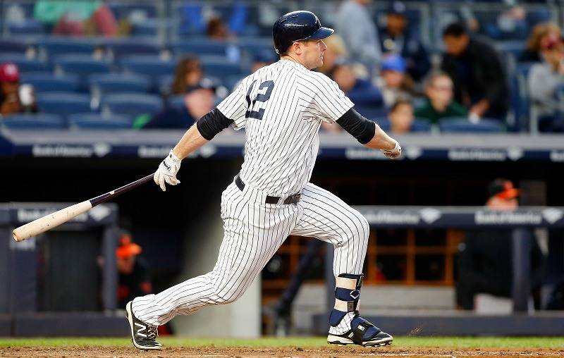 Chase Headley of the New York Yankees follows through on a sixth inning RBI double