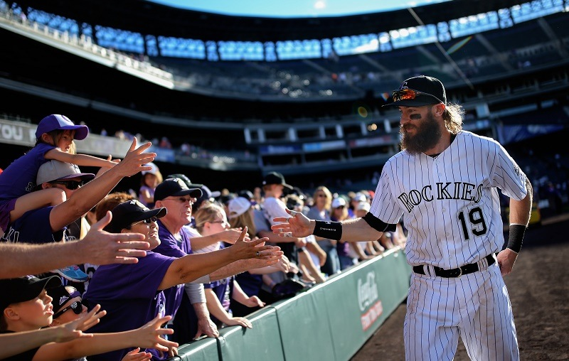 Charlie Blackmon of the Colorado Rockies shakes hands with fans after the final game of the 2016 season