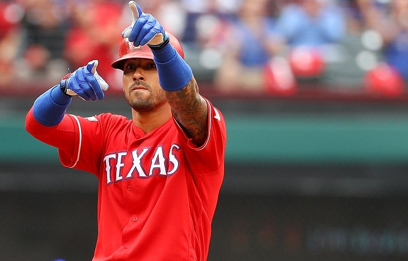 Ian Desmond of the Texas Rangers reacts after hitting a double against the Toronto Blue Jays in 2016