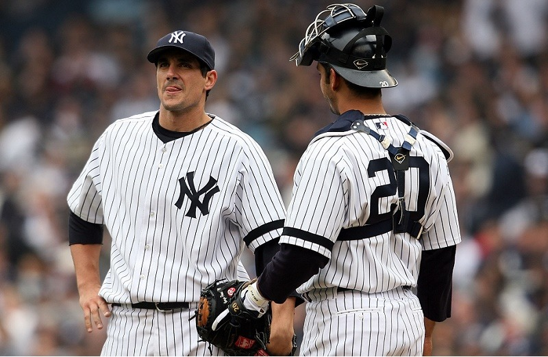 Starting pitcher Carl Pavano (L) of the New York Yankees talks with catcher Jorge Posada
