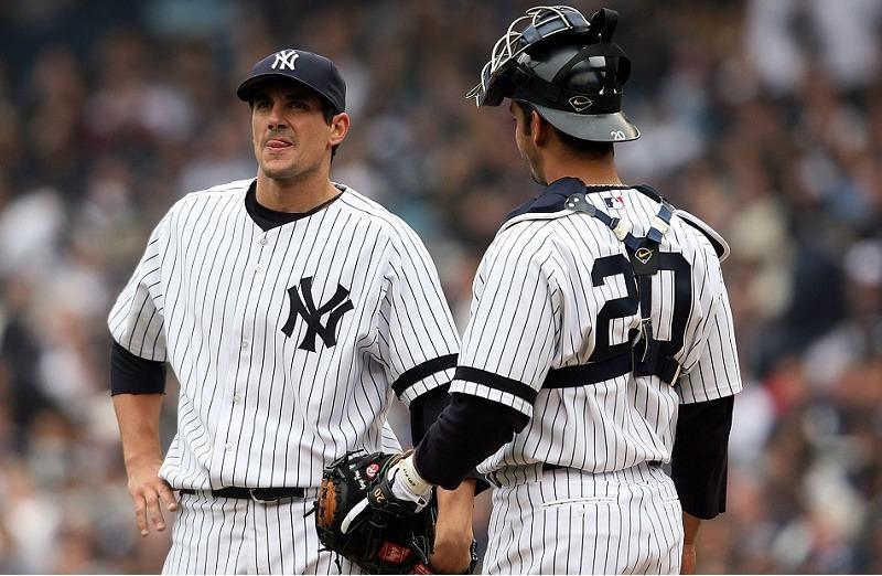 Starting pitcher Carl Pavano (L) of the New York Yankees talks with catcher Jorge Posada