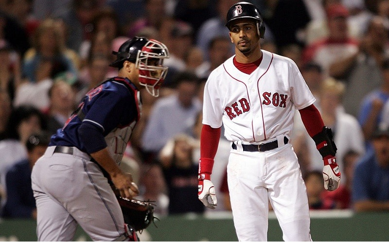 Julio Lugo (R) of the Boston Red Sox reacts after he struck out with the bases loaded