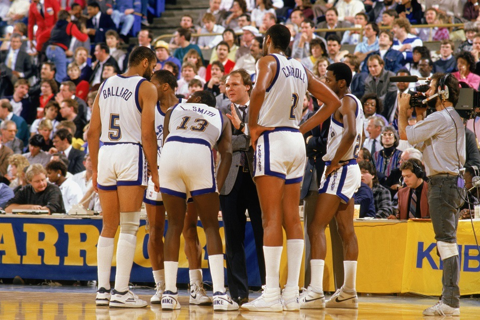 Members of the Golden State Warriors huddle with the coach.