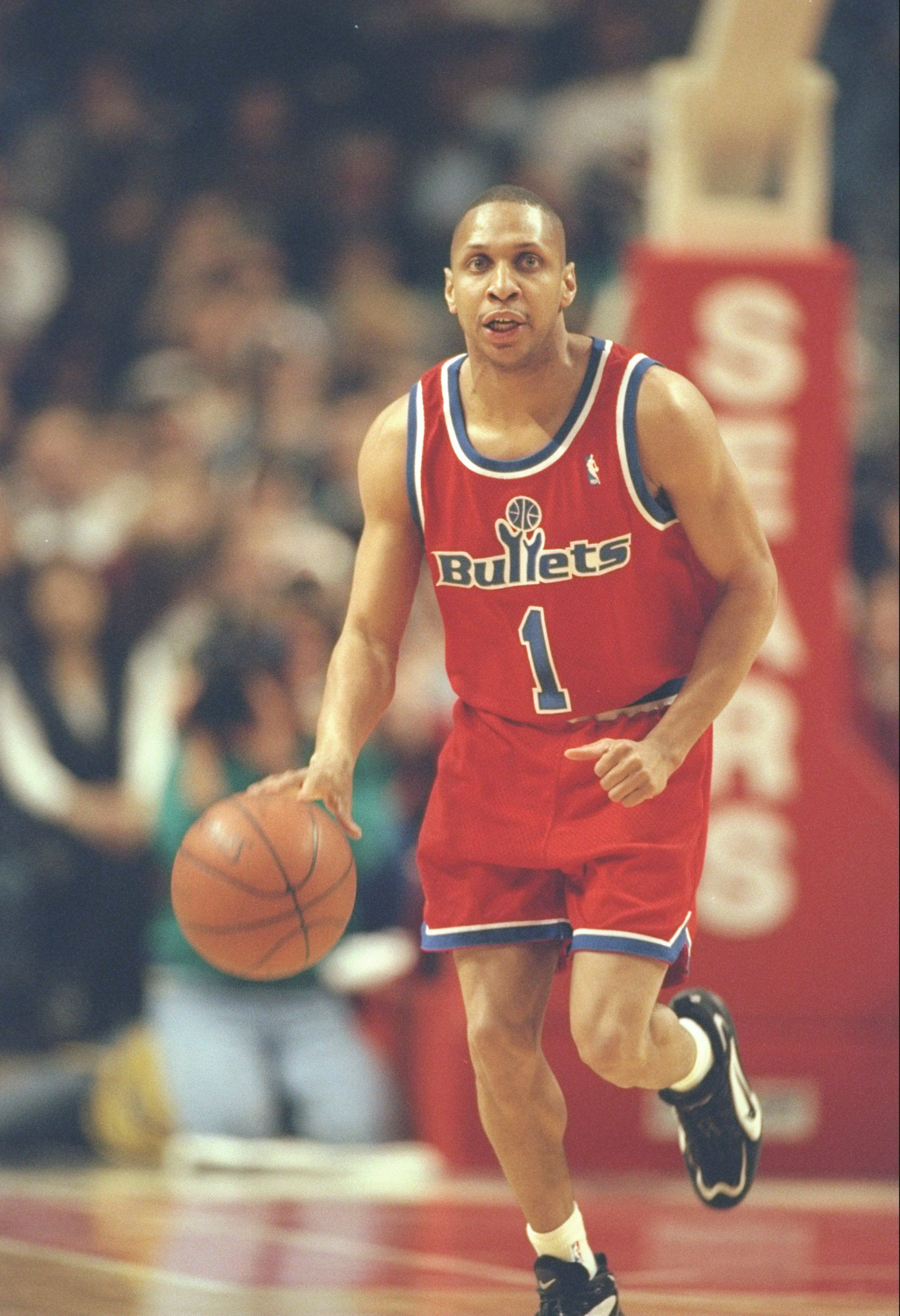 Guard Greg Grant of the Washington Bullets moves the ball down the court