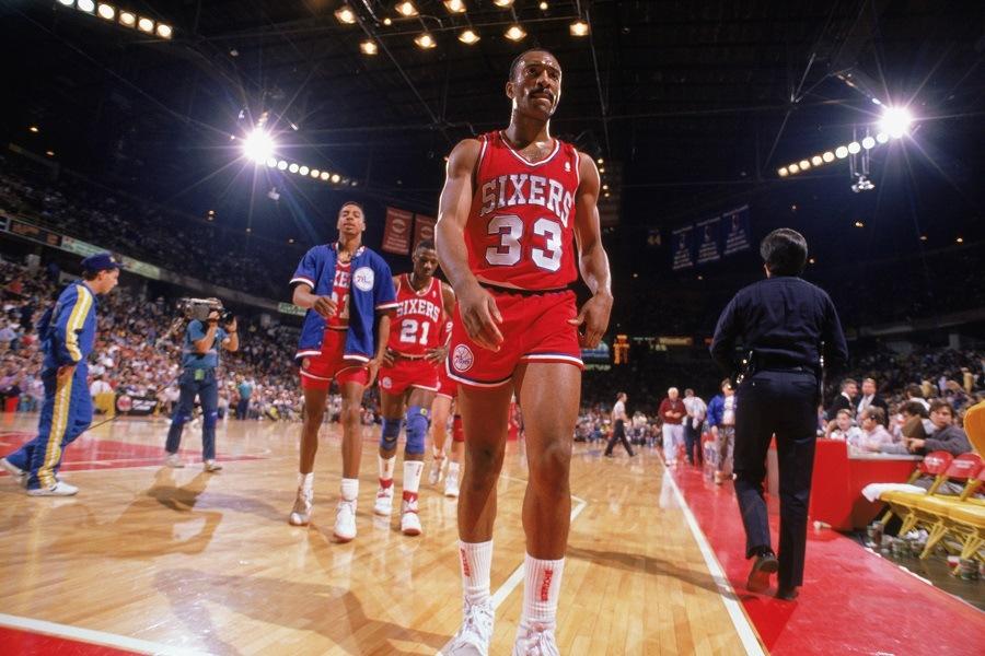 Hersey Hawkins of the Philadelphia 76ers walks off the court