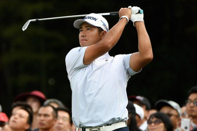 Hideki Matsuyama swings the club.