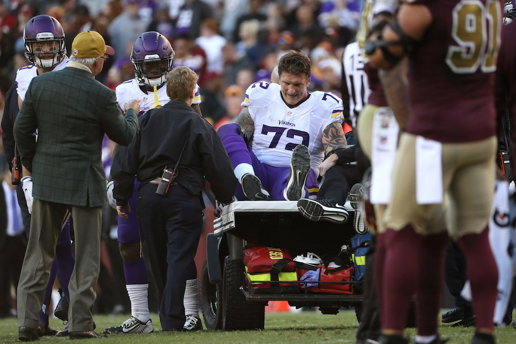Jake Long is carted off the field after he is injured | Patrick Smith/Getty Images