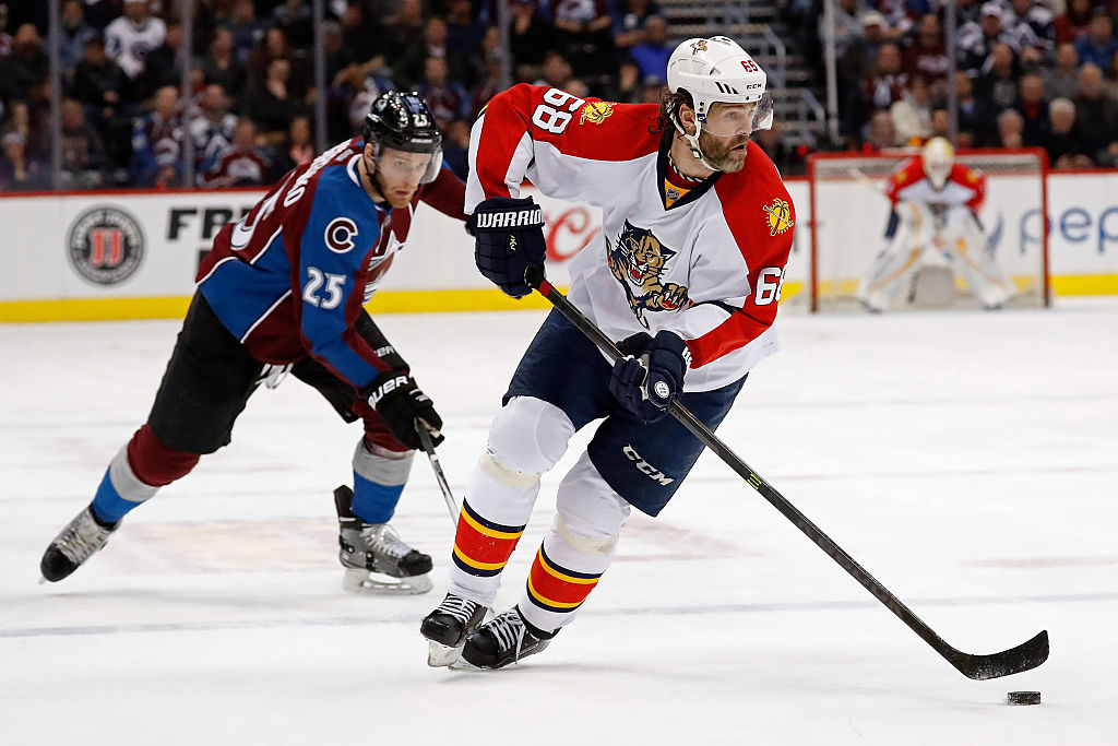 Jaromir Jagr of the Florida Panthers controls the puck against Mikhail Grigorenko of the Colorado Avalanche