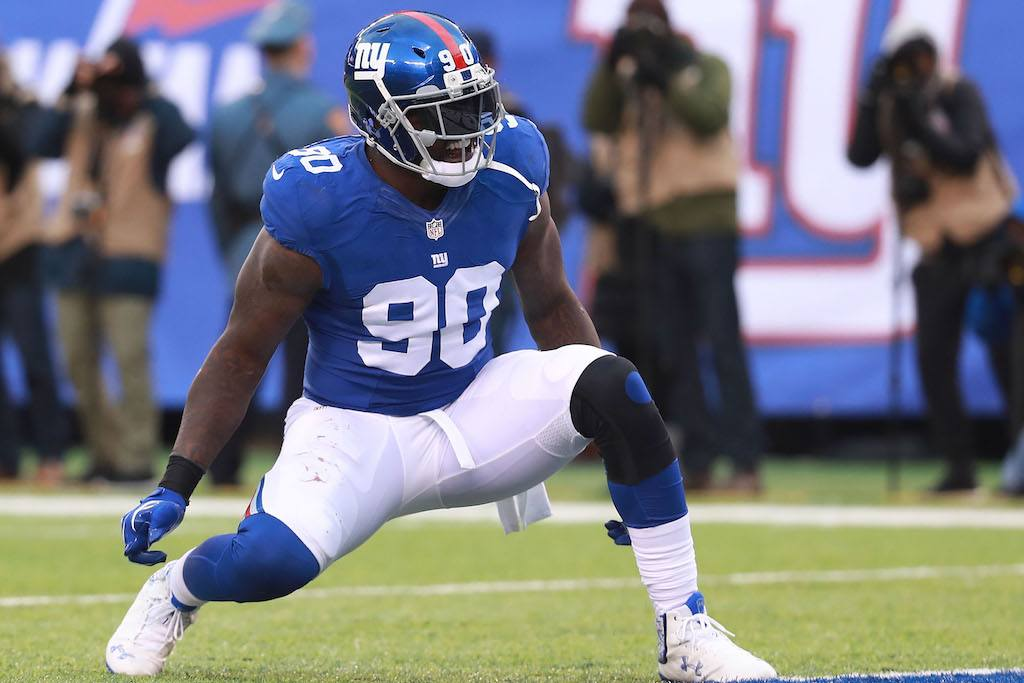 Jason Pierre-Paul stretches before a game.