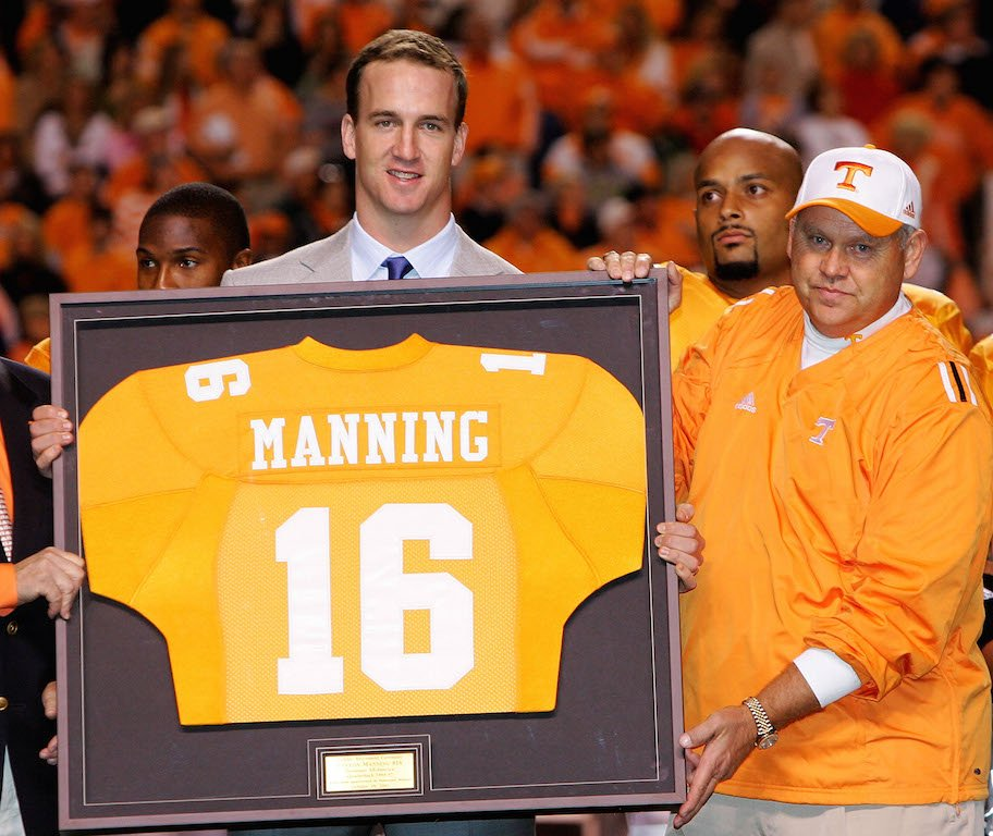Peyton Manning holds his jersey at Tennessee.