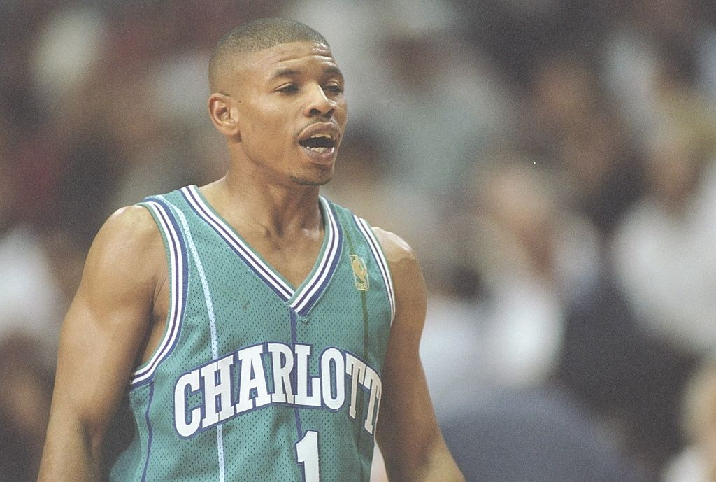 Guard Tyrone Bogues of the Charlotte Hornets stands on the court as the shortest NBA player in league history