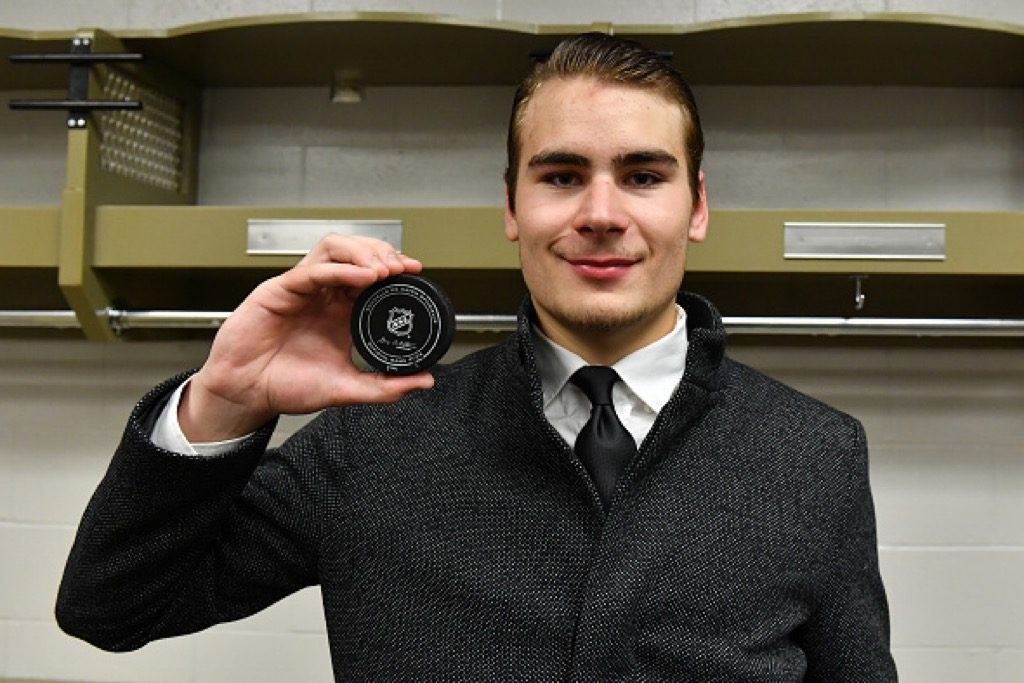 Timo Meier of the San Jose Sharks poses with the puck from his first career NHL goal | Francois Lacasse/NHLI via Getty Images
