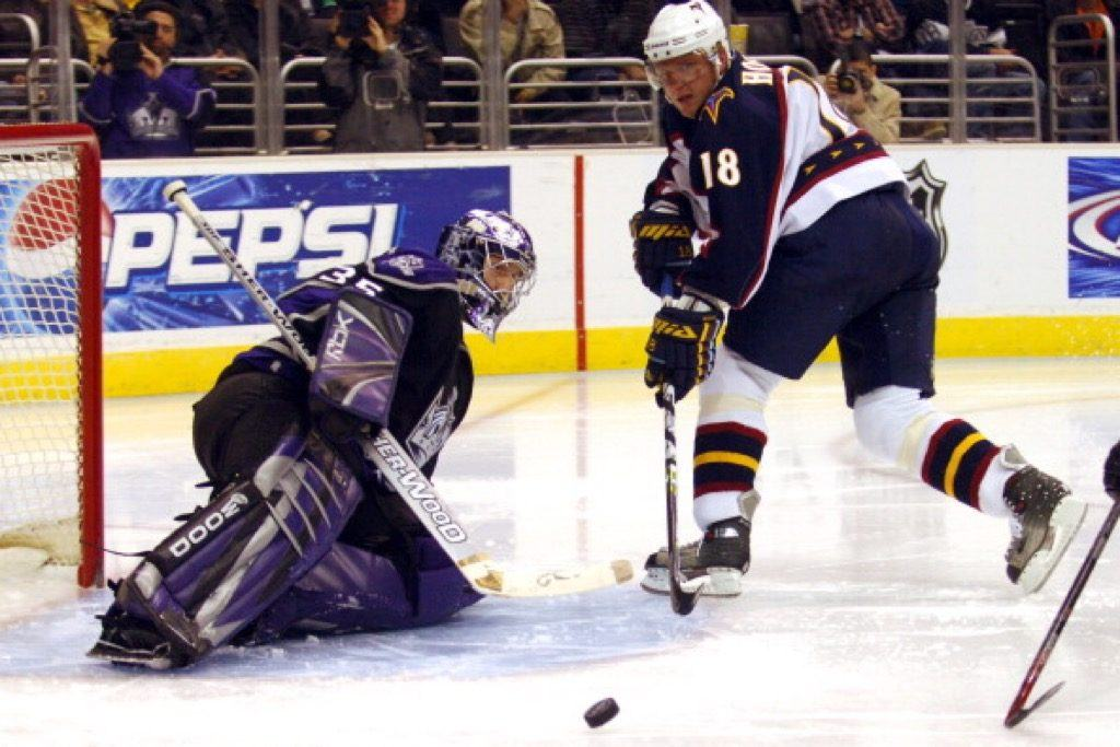 Los Angeles Kings goaltender Jason LaBarbera deflects a shot by Marian Hossa of the Atlanta Thrashers | Kirby Lee/NHLImages