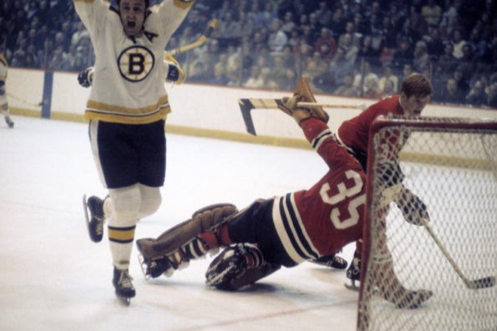 Boston Bruins Phil Esposito celebrates after scoring a goal against the Chicago Blackhawks goalie Tony Esposito | Heinz Kluetmeier/Sports Illustrated/Getty Images