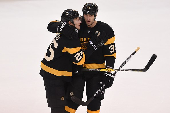 Brandon Carlo (L) and Zdeno Chara of the Boston Bruins celebrate a goal against the New York Rangers | Steve Babineau/NHLI via Getty Images