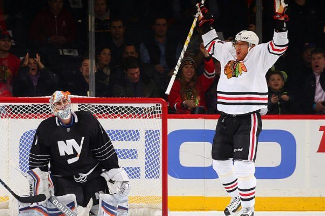 Marian Hossa of the Chicago Blackhawks celebrates his first period goal as Thomas Greiss of the New York Islanders looks on | Mike Stobe/NHLI via Getty Images