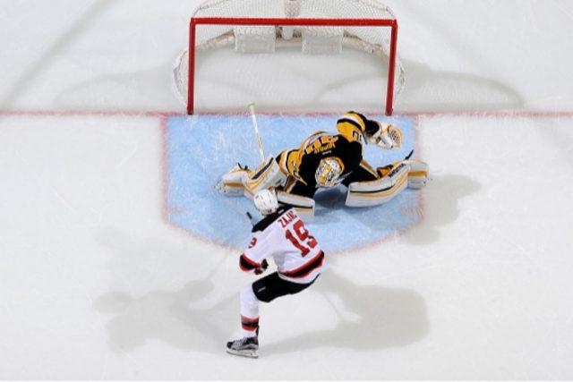 Matt Murray of the Pittsburgh Penguins makes a save on Travis Zajac of the New Jersey Devils during a shootout | Joe Sargent/NHLI via Getty Images