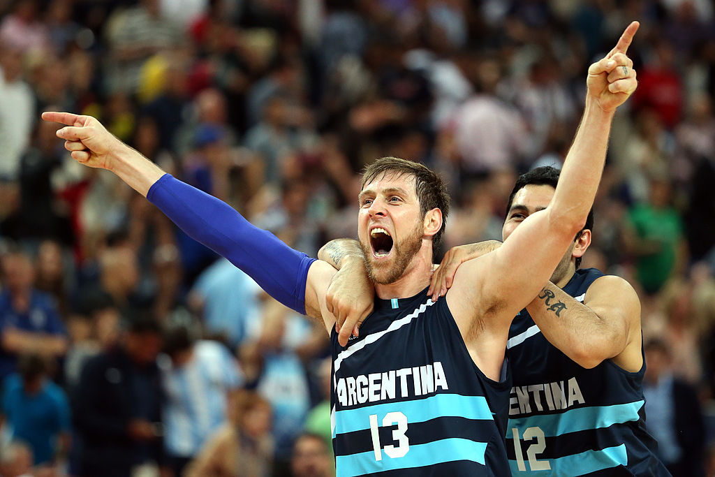 Andres Nocioni #13 and Martin Leiva #12 of Argentina