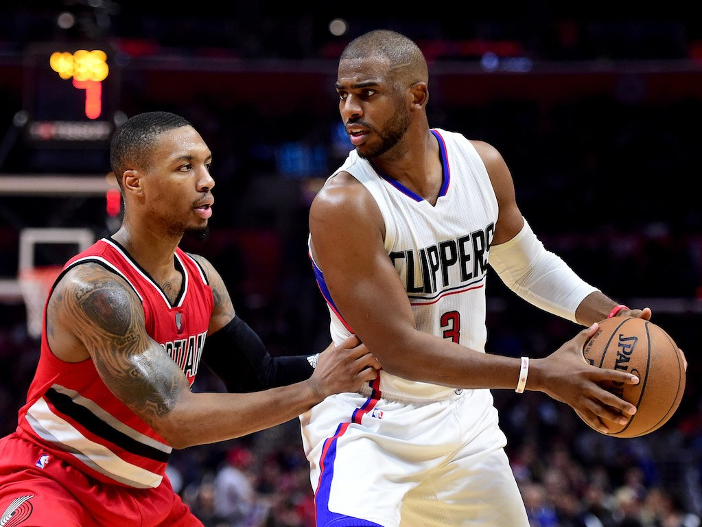 Chris Paul (R) looks to pass as he's guarded by Damian Lillard of the Trail Blazers | Harry How/Getty Images