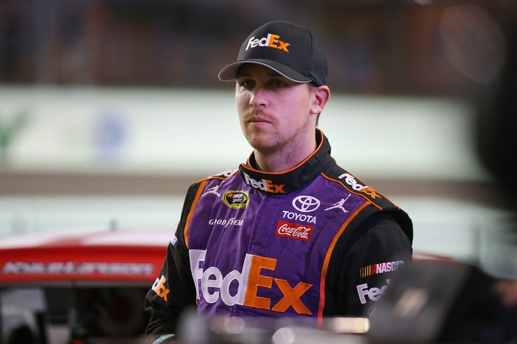 HOMESTEAD, FL - NOVEMBER 18:  Denny Hamlin, driver of the #11 FedEx Express Toyota, stands on the grid during qualifying for the NASCAR Sprint Cup Series Ford EcoBoost 400 at Homestead-Miami Speedway on November 18, 2016 in Homestead, Florida.  (Photo by Sarah Crabill/Getty Images)