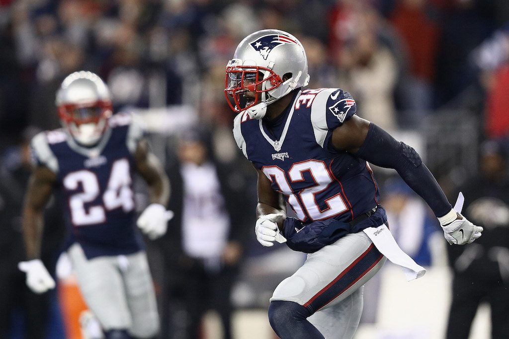 Devin McCourty cheers after scoring a touchdown.