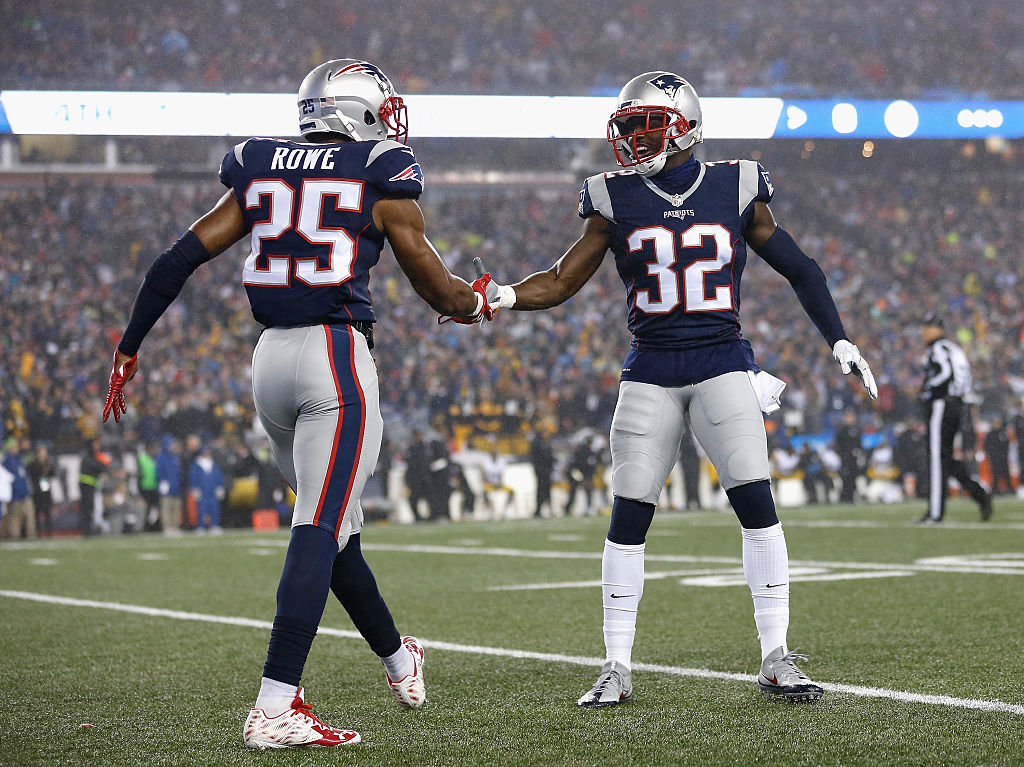 The New England Patriots Eric Rowe and Devin McCourty react in a game against the Pittsburgh Steelers.